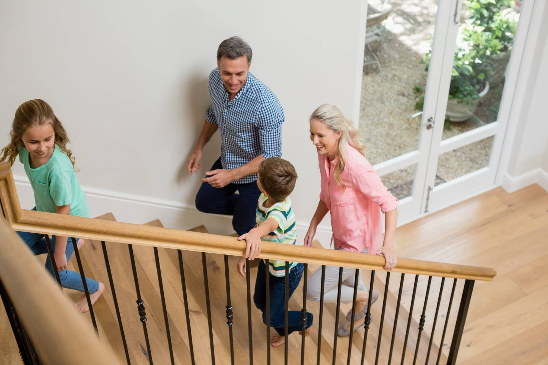 family on stairs in security protected home